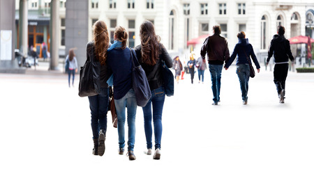 abstracts: A large group of young people. Urban scene.