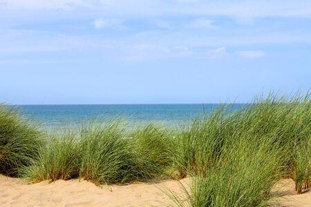 Duinen naar de zee. Zeegezicht. Stockfoto