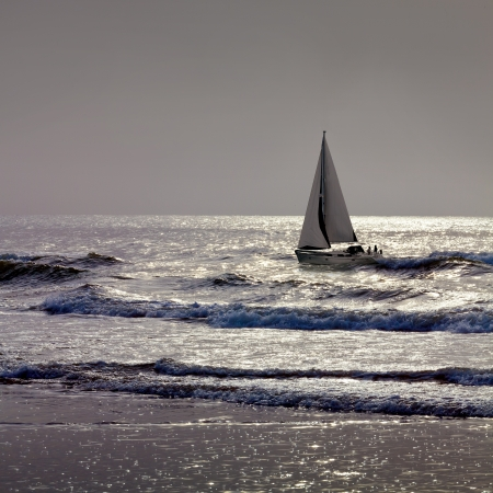 Yacht floating in the sea. Seascape. photo