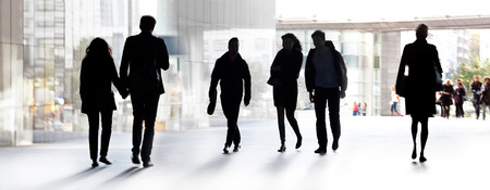 action blur: A large group of people on a light background. Panorama. Urban scene.