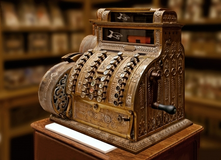 Old-time cash register in a shop. Old object.