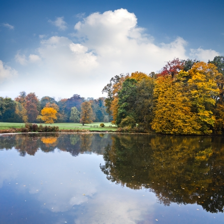 Autumn Landscape. Park in Autumn. The bright colors of autumn in the park by the lake. Stock Photo