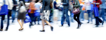 A large group of people walking. Blurred motion. Panorama. Standard-Bild