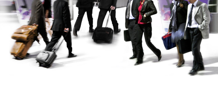 Group of business people walking. Arriving passengers. Blurred motion. Stock Photo