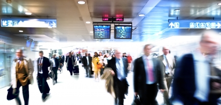 arriving: A large group of arriving business people. Panorama. Motin blur. Stock Photo