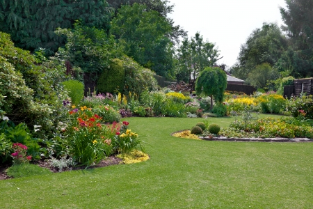 Green lawn in a colorful landscape formal garden. Beautiful Garden. Standard-Bild