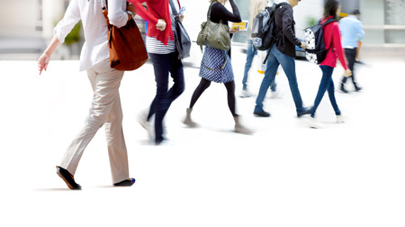 A large group of people walking. Blurred motion Stock Photo