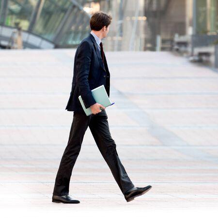 Going businessman. Urban scene.