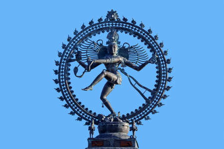 Nataraja, depiction of the Hindu god Shiva as the cosmic ecstatic dancer  Lord of the Dance against blue sky 写真素材