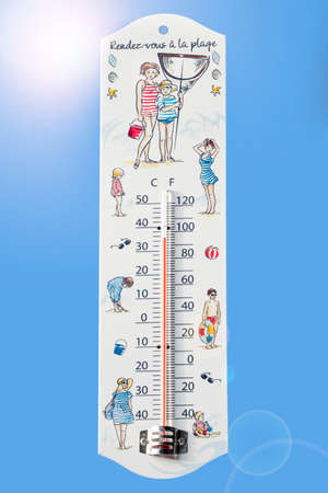 Thermometer measures extremely hot temperature of 34 degrees Celsius  34 ? C  93 ? F during heat wave  heat wave in summer