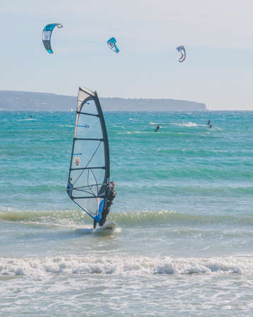 Windsurfing and kitesurfing in Can Pastilla, Majorca, a winter Sunday