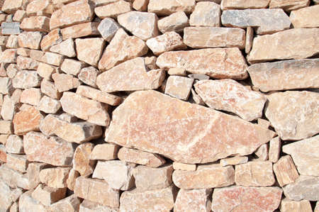 loosely: Wall of loosely fitted red rocks