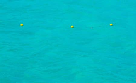 boyas: Tres boyas amarillas en el agua azul del Mediterr�neo