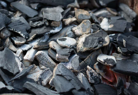 embers: Burnt charcoal and ash with a small glow