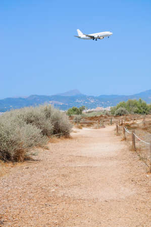 Jetliner landing in Son Sant Joan, airport of Palma de Mallorca photo