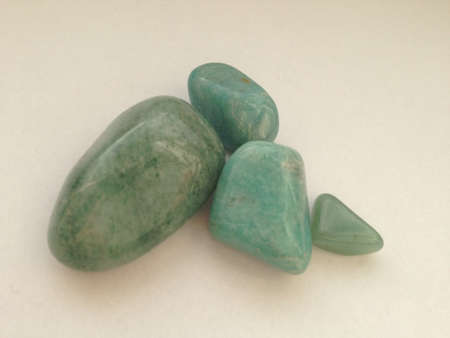 Green tumbled rocks for wealth and money luck. Stock Photo - 22340000