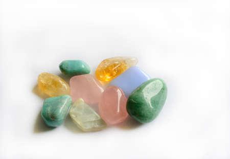 Group of color semi-precious gemstones such as citrine, aventurine, moonstone, rose quartz and blue calcite on white background Stock Photo - 22953352