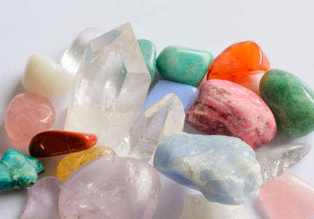 Collection of semi-precious stones such as rose quartz, amethyst, aventurine, turquoise, citrine, quartz, blue calcite, milk quartz, rhodochrosite  photo