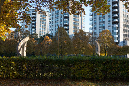 sun dial: Solursparken in the autumn with the sculpture Sun Dial and high rise buildings  Editorial