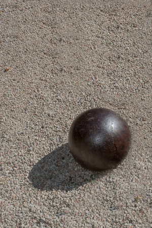magnetic stones: Iron ball on gravel with shadow