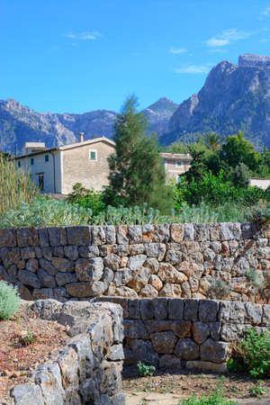 drystone: Mountain landscape with house and drystone wall, Majorca in October