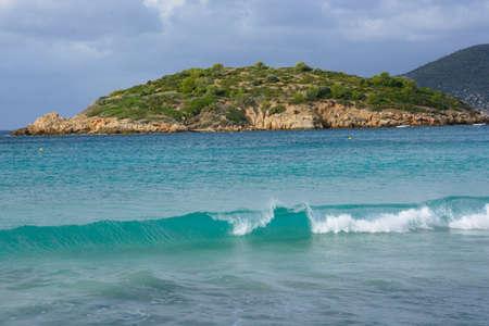 Breaking wave on Sant Elm beach, Andratx, Majorca, in October  photo