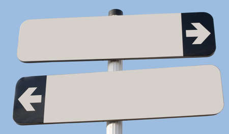 Two signs pointing in opposite direction with copy space and blue sky photo