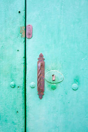 Green vintage door with old rusty locks  photo