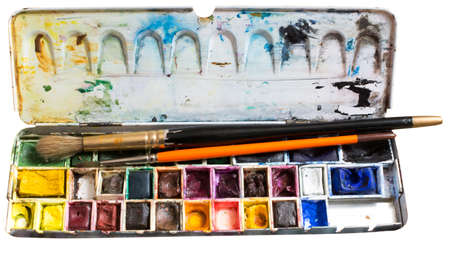 Watercolor box. Artist tools - a well used and messy watercolor box and fine Kolinsky brushes.