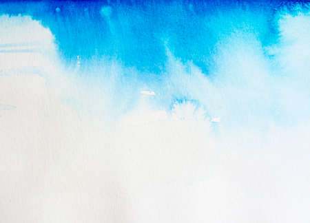 Watercolor background Heavens. Abstract blue textured watercolor background with whirls and splashes fading into white copy space on the bottom.