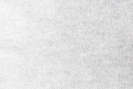artisanry: Light gray knitwork  Light gray wool knitwork full frame for warming backdrop or background