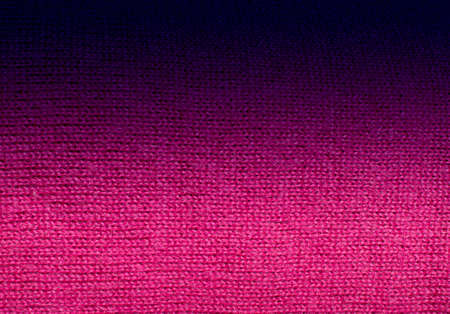 artisanry: Pink fuchsia knitwork fade to black  Pink fuchsia wool knitwork full frame for warming backdrop or background