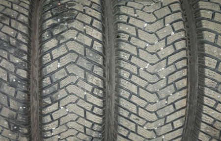winter tires: Rubber tires background  Car mechanic garage switch to or from summer or winter tires in April or October, Stockholm, Sweden
