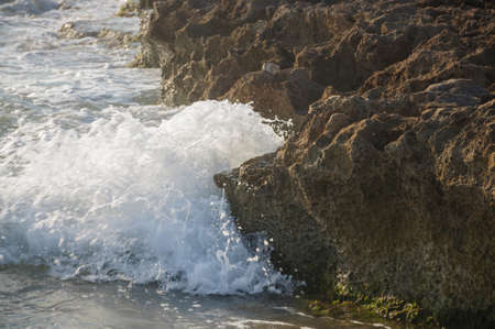 costa blanca: Eroded limestone rock and wave, La Zenia, Costa Blanca, Spain