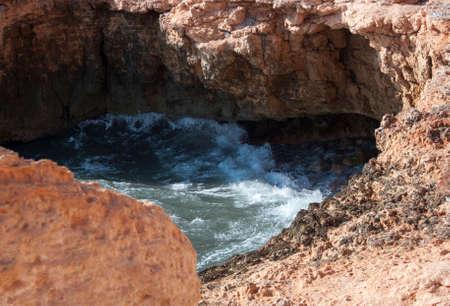 Sea water eroding heart shaped cavity  La Zenia, Costa Blanca, Spain  版權商用圖片