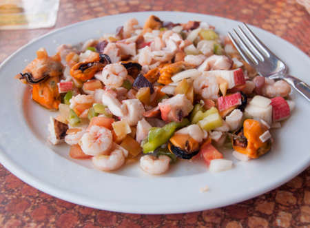 marisco: Plate with seafood such as pulpo, gambas, shrimp, mussels and vegetables. Spain.