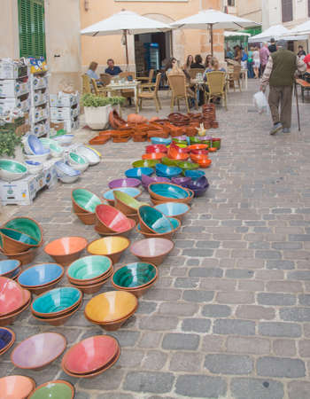 artisanry: Colorful ceramics on the Santanyi market, Majorca, Balearic islands, Spain.
