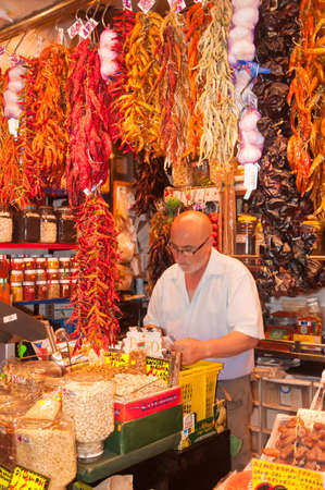 josep: Spice store owner at St Josep market. Barcelona, Spain on July 31, 2012.