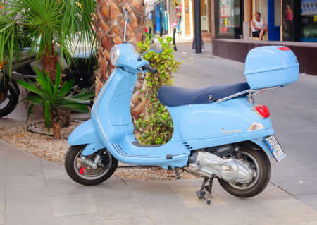 Baby blue scooter parked, a typical street scene in the Mediterranean area. Here in Torrevieja, Costa Blanca, Spain.