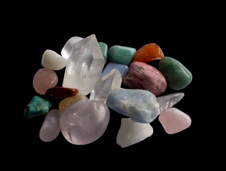 semiprecious: Semi-precious gemstones in a glittering rich centered heap. Quartz, aventurine, calcite, jadeite and others. Stock Photo