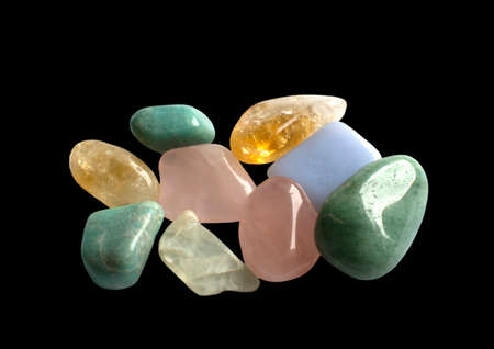 calcite: Semi-precious gemstones in yellow, green and pink, isolated on black. Quartz, aventurine, calcite, jadeite and others.