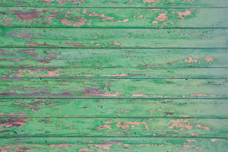 paintjob: Green flaky painted surface. Green flaky painted wooden planks horizontal full frame for grungy background.