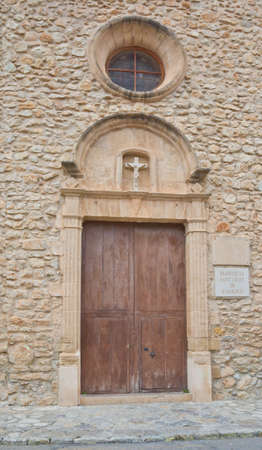 crist: ARRACO, MAJORCA, SPAIN - OCTOBER 30 2013: Detail door and cross Sant Crist church on October 30 2013 in Arraco, Mallorca, Balearic islands, Spain. Editorial