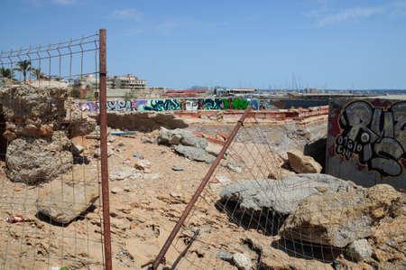 trashy: Demolition area with graffiti. Cala Estancia needs an uplift. The demolition back area of Cala Estancia with graffiti. Mallorca, Balearic islands, Spain.
