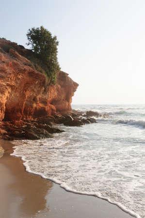 costa blanca: Red rock coast line. Costa Blanca, Spain.