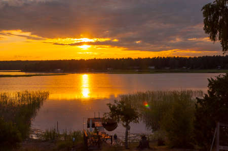 karlstad: Midsummer sunset at around 10 pm with a promise of a beautiful day. Lake Vanern, Karlstad, Sweden.