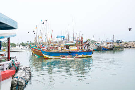 TANGALLE, SOUTHERN PROVINCE, SRI LANKA, ASIA - DECEMBER 20, 2014: Colorful wood fishing boats moored on December 20, 2014 in Tangalle port, Southern Province, Sri Lanka.