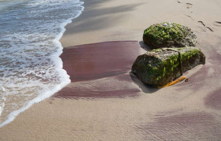 southern sri lanka: Sandy beach with red mineral deposits in Tangalle, Southern Province, Sri Lanka, Asia.
