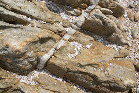 rocky point: Calcite vein in rock at Rocky Point, Tangalle, Southern Province, Sri Lanka, Asia. Stock Photo
