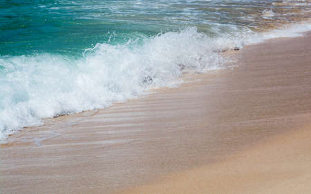 southern indian: Green water and seaspray on sandy beach closeup in Southern Province, Sri Lanka, Asia. Stock Photo